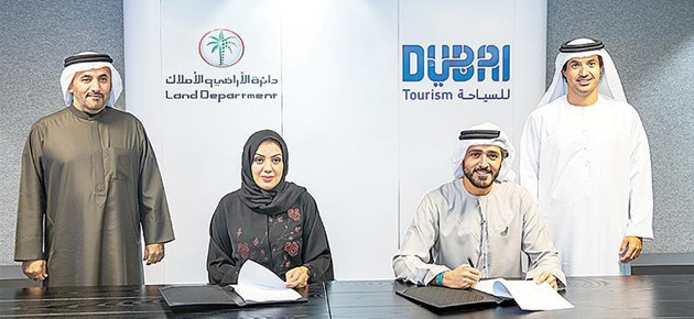 مذكرة تفاهم بين دبي للسياحة وأراضي دبي لترويج العقارات